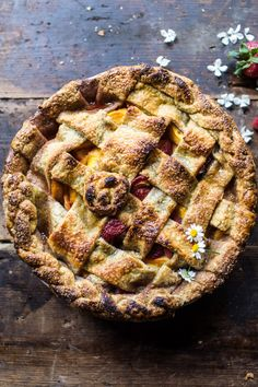 Honey Strawberry Peach Pie - my favorite super easy pie crust filled with two of my most favorite fruits & topped with a golden crust @ halfbakedharvest.com