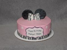 Zebra striped Minnie Mouse themed birthday cake