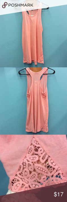 Pink tank top with racer back loose fit Freshman brand size Medium loose fit racer back tank brand new with tags. The bottom sides have a see through design as pictured. Price firm no trades. Thank you for shopping on Posh! Freshman Tops