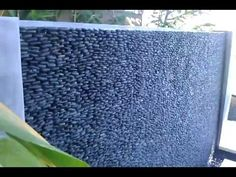 Water Wall - Guy constructs a wall of water on a budget . This is a design to build a waterwall with a mechanical motorized actuator.