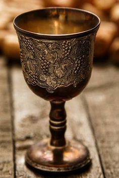 Medieval Goblet And Wine Corks On Wooden Table Stock Photo, Picture And Royalty Free Image. Medieval Life, Medieval Fantasy, Marguerite De Navarre, Hawke Dragon Age, Wine Goblets, Mason Jar Wine Glass, Wooden Tables, Middle Ages, Dinnerware