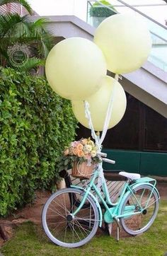 Guide your guests through an outdoor wedding space by tying balloons to the handlebars.