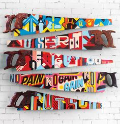 Hand-painted typography on vintage saws.By Vault49, New York.