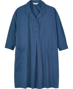 Toast 100% cotton smock dress. Oversized shirt dress in soft cotton. Two large slanted patch pockets. Soft collar. Four button placket with inverted box pleat below. Buttoned cuffs on easy, 3/4 length sleeves.