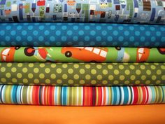 love this set of fabrics: blues, greens and cars