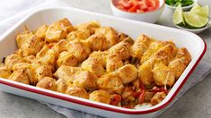 Cheese, chicken and Pillsbury biscuits come together in this zesty dinner bake that shows the most scrumptious way to eat fajitas actually is in your 13x9-inch pan.
