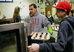 Jeff Klein and his son Cael bake cookies as part of Friday's free community Christmas meal at Food at First. Photo by Sarina Rhinehart/Ames Tribune  http://amestrib.com/news/free-festive-christmas-dinner