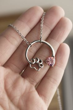The bond between you and your pet is special and held close to your heart. Our paw print birthstone necklace is a charming display of how much your furry friend means to you! Choose their birth month, or if you are unsure of their birth date, you can choose the month that your pet joined your family.