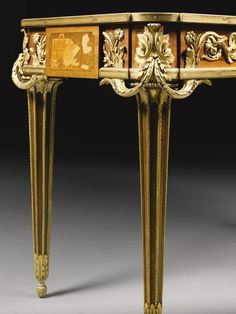 FRANÇOIS LINKE 1855 - 1946 A LOUIS XVI STYLE GILT BRONZE MOUNTED MAHOGANY, SYCAMORE AND FRUITWOOD MARQUETRY CENTER TABLE, PARIS, LATE 19TH/EARLY 20TH CENTURY, INDEX NUMBER 251, AFTER THE CELEBRATED MODEL BY JEAN HENRY RIESENER the top finely decorated with an elaborate marquetry representing mythological figures of Urania and Calliope, with respective attributes of astronomy and poetry, one bronze mount has been removed to reveal the FL mark from the bronze master model