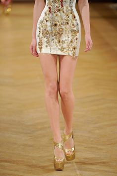 Viewing the minidress as work of art on the Tony Yaacoub Haute Couture Fall 2013 runway.
