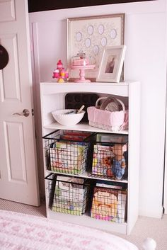 bottom two shelves contain baskets full of her books