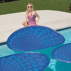 The Solar Pool Heating Rings - Hammacher Schlemmer - These are the floating rings that harness the power of sunlight to raise the temperature of an average-sized pool by 3º - 4º F per week. They require less effort to maneuver and store than traditional tarp covers, and eliminate the need for energy-consuming electrical heaters when covering just 70% of the pool's surface. A must buy!