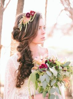 Stunning for a wedding(I love how the flowers in her hair match the flowers in her bouquet) or any special occasion.