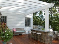 Country style #outdoorkitchen on beautiful stained #backyarddeck and covered with white #pergola.