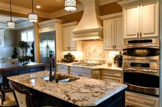Country Kitchen with Stainless Undermount 2-Basin Sink, Vintage Granite Countertop, Integra Raised Panel