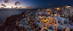 Santorini buzzing with lights and activity.