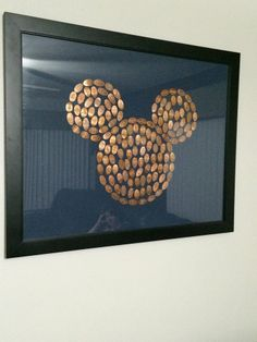 """Pressed Penny Display! This was posted to the DisneyWorld Junkies FB Page by J.Hassler: """" I wanted to do something more with the pressed pennies than just keep them in the little books you buy at the parks... framed Mickey head! Looks even cooler in person..."""""""
