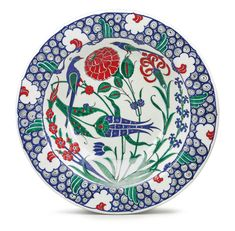 A TURKISH IZNIK-STYLE POTTERY POLYCHROME CHARGER, MODERN in 16th-century Iznik style, black painted artist's mark in Arabic for Adnan Hodja. diameter 14 1/4 in.
