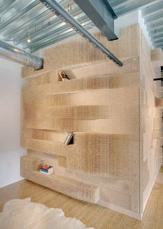 """""""Peg Wall Bookcase"""" by Elizabeth Whittaker of Merge Architects. The wood floor and wall design softens the industrial ceiling. Peg Wall, Retail Shop, Office Interiors, White Interiors, Retail Design, Interiores Design, Store Design, Architecture Design, Bookcase"""