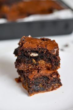 Ultimate Chocolate Chip Oreo Brownies baked golden brown and topped with french vanilla icecream, the best dessert recipe all in one.