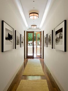 Decoration,Narrow Hallway Lighting Ideas With Drum Shade Ceiling Light And Wall Mounted Painting Featuring Beige Rug Area And Laminated Wooden Flooring Combine With Swing Glass Door,Classy Narrow Hallway Lighting Ideas