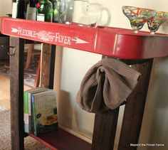 Beyond The Picket Fence: Flexible Flyer Fun - add a base or legs and a bottom shelf (screw in a few hooks)  use as bar cart, potting table, planter, bathroom for towels and lotions on a front porch, shorter legs for coffee table