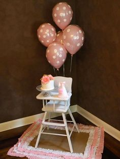 1st girl birthday highchair overflowing with sweetness.  See more first girl birthday party ideas at www.one-stop-party-ideas.com