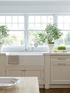 marble counters, sink, wall of windows