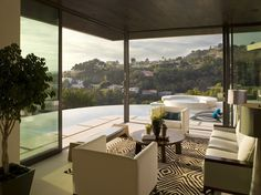 Living room opens onto pool and then views of the Hollywood Hills interior by Lori Denns