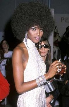 1990, Fashion 'Fro    At a party with photographer Steven Meisel, Naomi Campbell rocked an oversized, Angela Davis-esque afro.