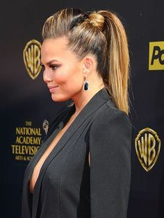Ponytail Hairstyles - Chrissy Teigen's high, voluminous pony with a pouf   allure.com