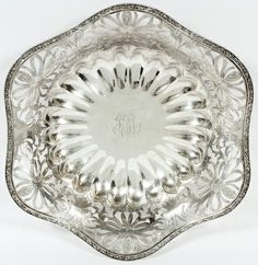 "GORHAM STERLING OPENWORK CENTERPIECE BOWL, EARLY 20TH C., W 13 3/4"":The undulating rim made with an openwork design of flower blossoms and a lobed center well enclosing the monogram 'JEM'. Marked to the underside with maker's mark, pattern number, and sterling. Weighs 26.84 troy ounces."