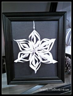 framed snowflake and snowman