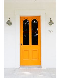 Orange door with symmetrical lights and oversized arch windows. I'm really into orange door. Yellow Doors, Exterior Paint, Painted Doors, House Exterior, Entrance Doors, Beautiful Front Doors, Beautiful Doors, Yellow Front Doors, Doors