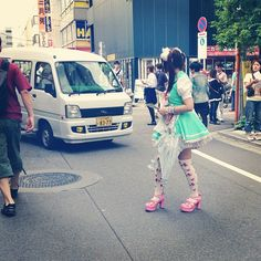 Maid crossing the street, Akihabara, Tokyo.