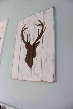 White Distressed Deer Head Silhouette Wood Sign. Ok HEATHER.......bedroom redo :) For Jalen. I know u can do this...over the sports pic u painted??