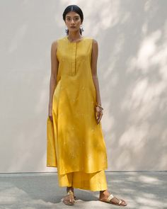 High Slit Kurta - Yellow from Women collection at Nicobar. Nicobar is for modern consumers who seek connection with things they acquire. Simple Kurti Designs, Salwar Designs, Kurta Designs Women, Casual Indian Fashion, Indian Bridal Fashion, Indian Dresses, Indian Outfits, Indian Clothes, Dress Paterns
