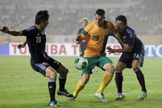 HWASEONG, SOUTH KOREA - JULY 25: Tomi Juric of Australia compete for the ball with Yuzo Kurihara and Hideto Takahashi of Japan during the EAFF East Asian Cup match between Japan and Australia at Hwaseong Stadium on July 25, 2013 in Hwaseong, South Korea.  www3.daylife.com/photo/01KF1S4870bYK