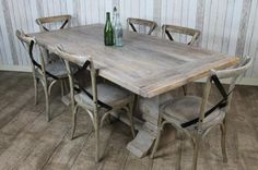 Distressed limed elm table. A rustic limed table made fro reclaimed materials. Available in 3 sizes and with benches which complement the table, this limed