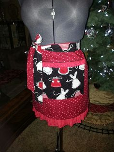 Adorable double sided half apron.  Any domestic diva would love it! Cute polk-a-dots on one side and retro aprons on the other. $35.00