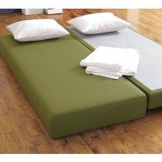 """The CB2 Lubi looks great set up as a daybed. The top mattress can be placed next to the bottom to make a bigger than queen, 10"""" narrower than king size bed. A king fitted sheet wouldn't stay in place or hold the two pieces aligned. Likewise if you had two complete Lubis next to each other. At 8.5""""H, this mode won't serve older guests' needs. The two mattresses have very different firmnesses, but that could be a plus for any given pair of guests! Overall, this one offers a lot of possibilitie..."""