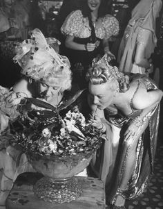 Women sipping punch from a big bowl at a costume party. Photograph by Peter Stackpole. Vintage Photographs, Vintage Photos, Vintage Happy New Year, New Year Pictures, Vintage Champagne, Women Smoking, Animal Party, Party Animals, Women In History