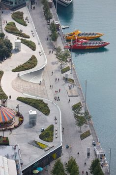 Kiosks with stainless steel canopies and a towering glass and chrome sculpture are among the recent enhancements made to Chicago's Navy Pier, one of the largest public piers in the world