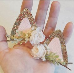 These flower adorned feline ears are the purrrfect addition to any Easter basket or Spring wardrobe! Super light weight & come attached to 2.5 inch alligator clips making them suitable for even the littlest ladies...  Each ear measures approx 2.5 in wide x 2 in tall. Listing is for a PAIR of ears...  MADE TO ORDER & Ships in 3-5 business days via USPS first class mail. International and expedited shipping available...  Custom requests of any kind are welcome - please message me :)  **...