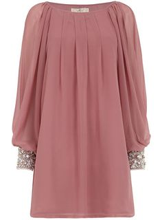 Tunic with embellished cuff. Instead of embellished cuff, use an embellished sleeve.