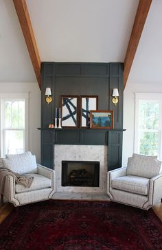 Hunter green fireplace with abstract art and unique blue patterned chairs #fireplace #shibori