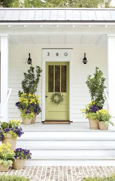 Beautiful Front Door Paint Color Ideas - Southern Living Signal your style to your neighbors through a vibrant or calm door color – it's your choice! Front Porch Garden, Front Porch Planters, Front Door Porch, House Front, Front Porches, Garage House, Garden Planters, Front Door Paint Colors, Exterior Paint Colors For House