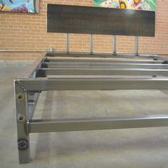bedframe from weldhouse.com . furniture from repurposed sheet metal of old American cars and trucks.