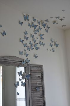 PAPILLONS (This is stunning but my house is just too dusty to put something like that up. I'd have cobwebs hanging off them in a week!)