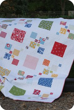 It's kinda hard to make quilts for boys that don't rely on 'boy' prints, but this would be super cute for a boys room!  Blue, green, brown, tan, while, orange...